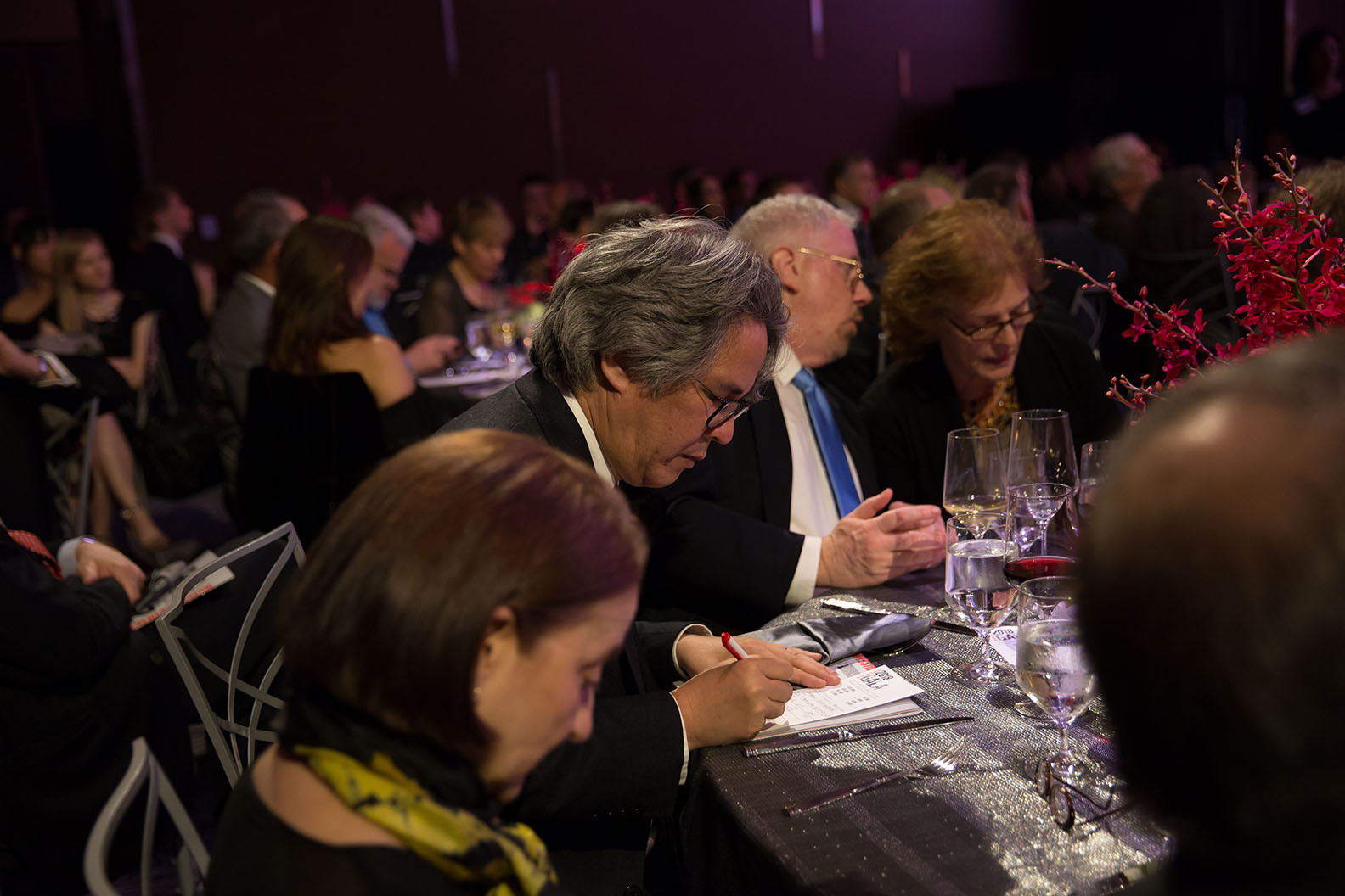 Gala attendees at a dinner table