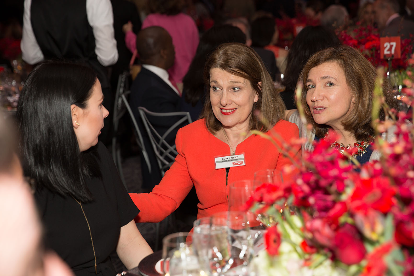 Gala guests chatting at a dinner table