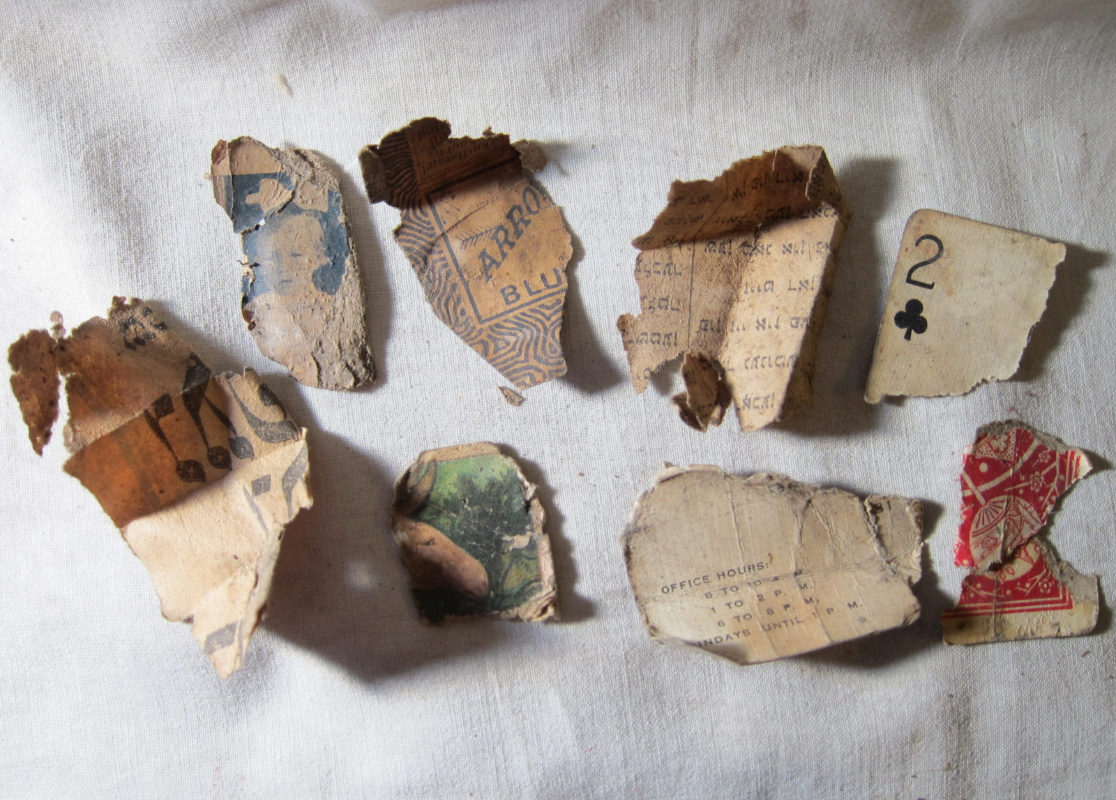 Assorted pieces of torn paper and artifacts found at 97 Orchard Street
