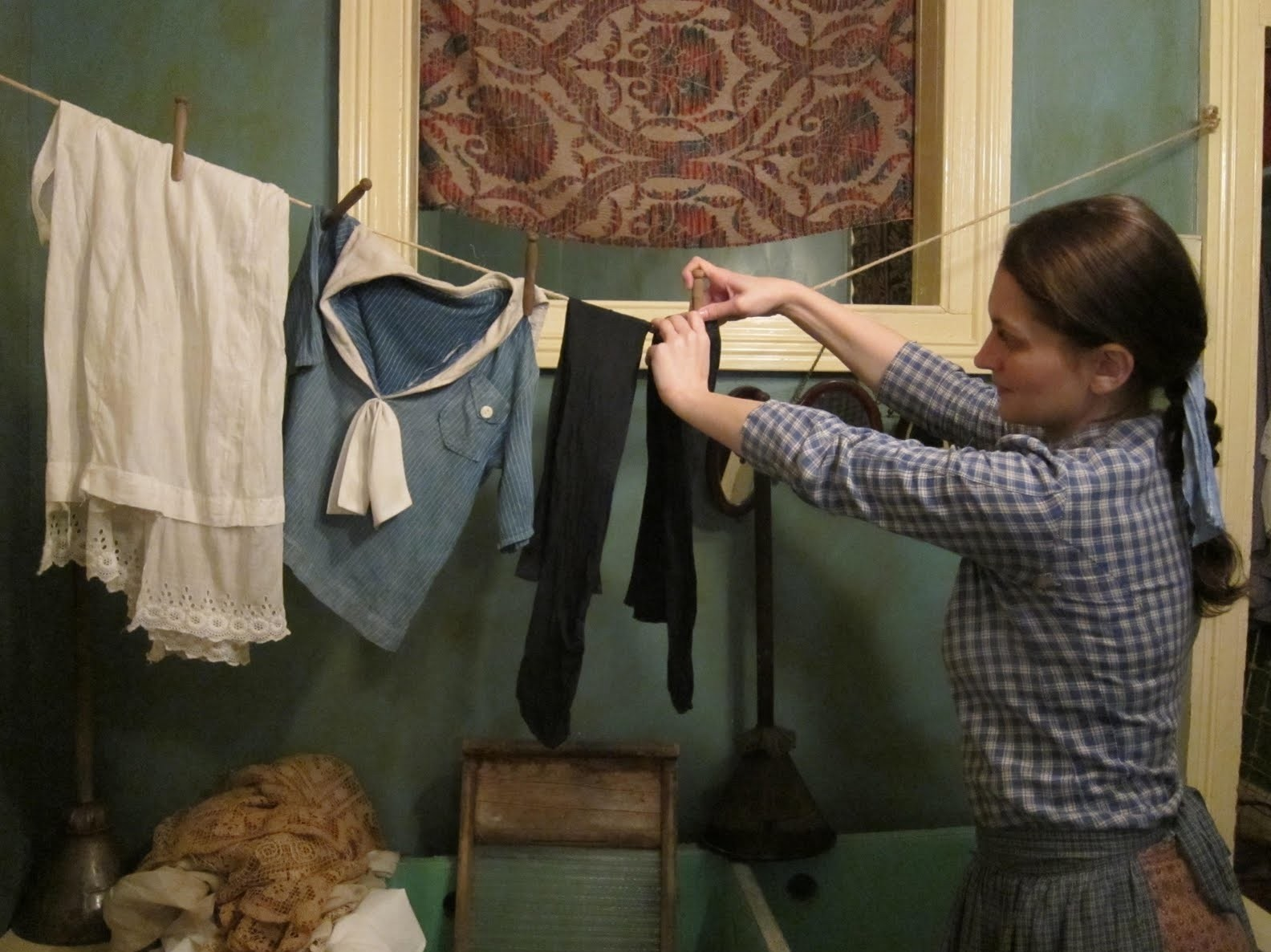 Actor playing the role of Victoria Confino in her family's recreated 97 Orchard Street Tenement Apartment