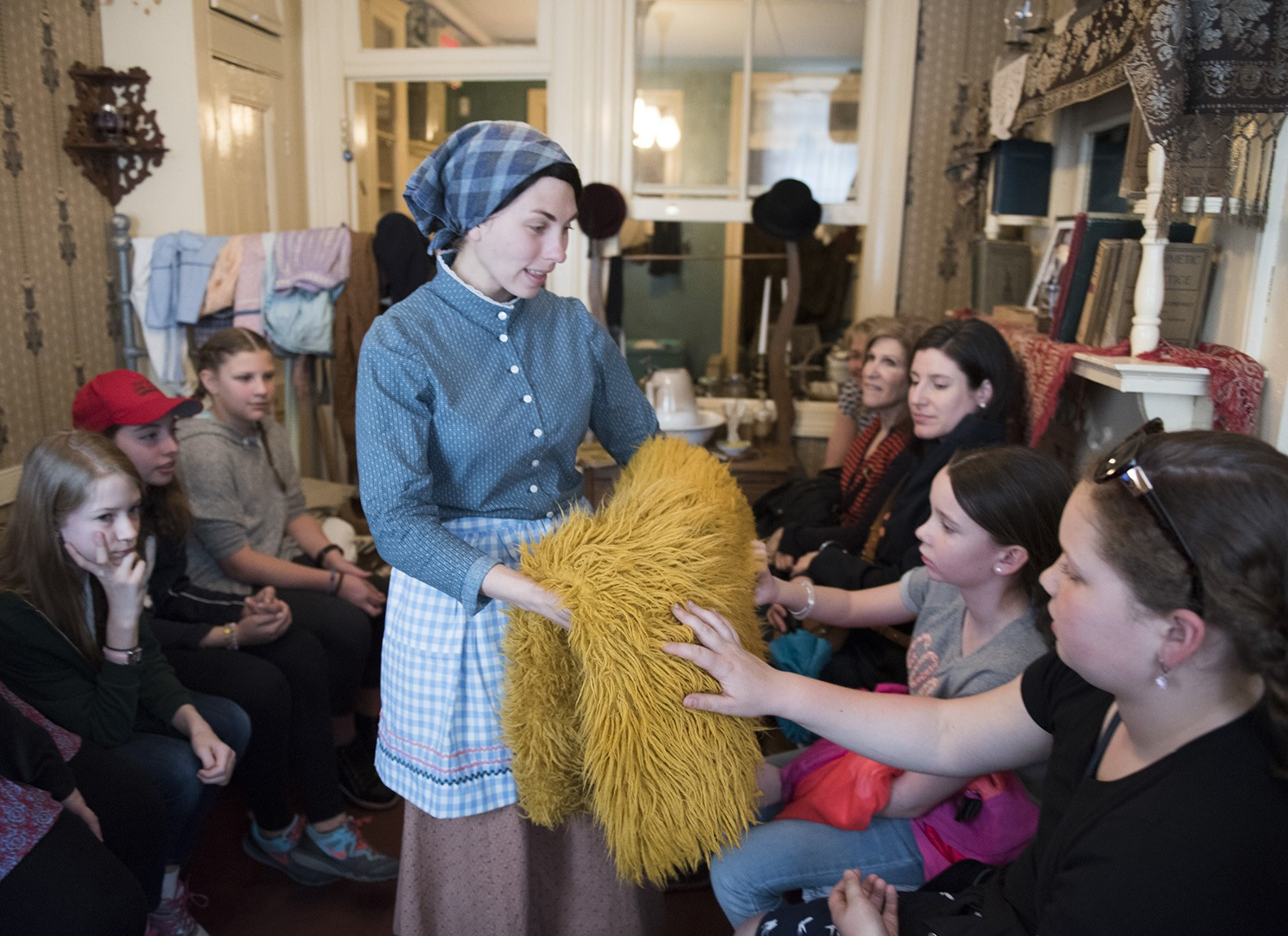 An actor portraying Victoria Confino shares stories with Museum visitors