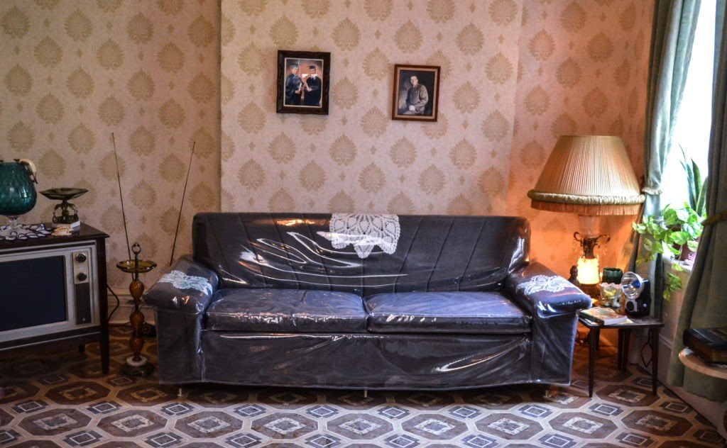 A couch inside the recreated living room of the Saez-Velez family apartment at 103 Orchard Street
