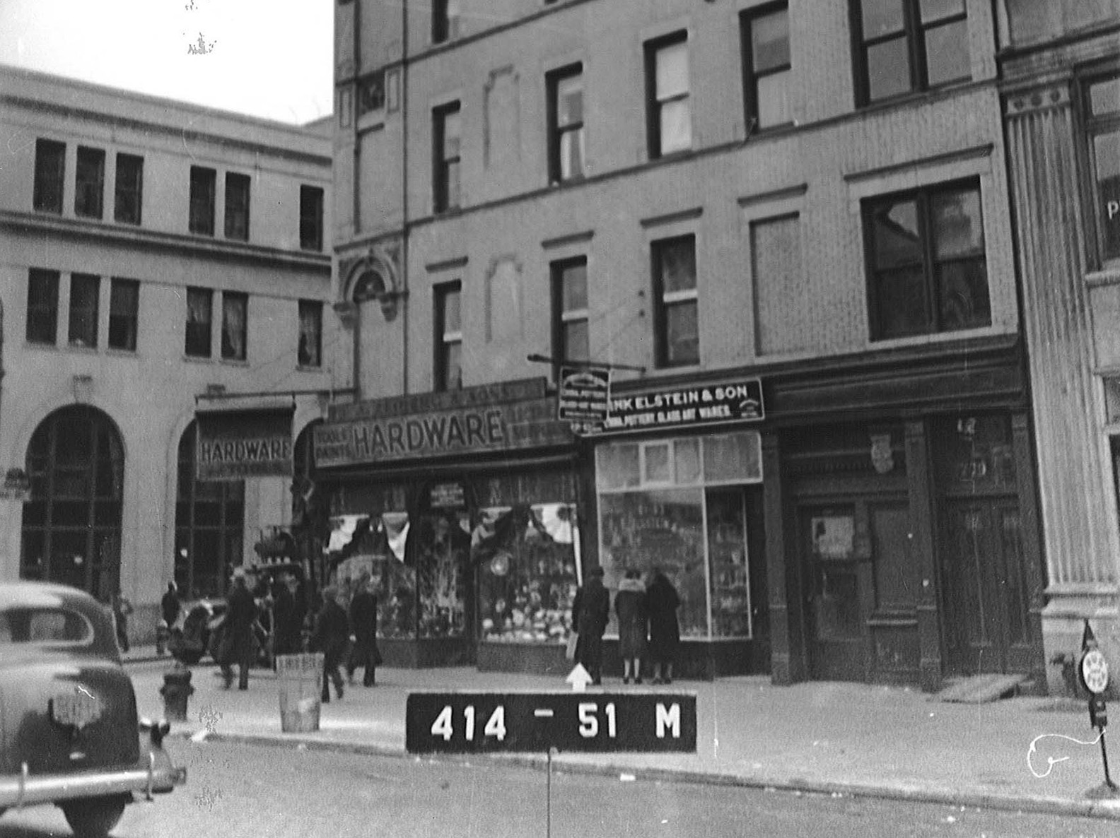 Street view of a hardware storefront at 103 Orchard in the 1940s