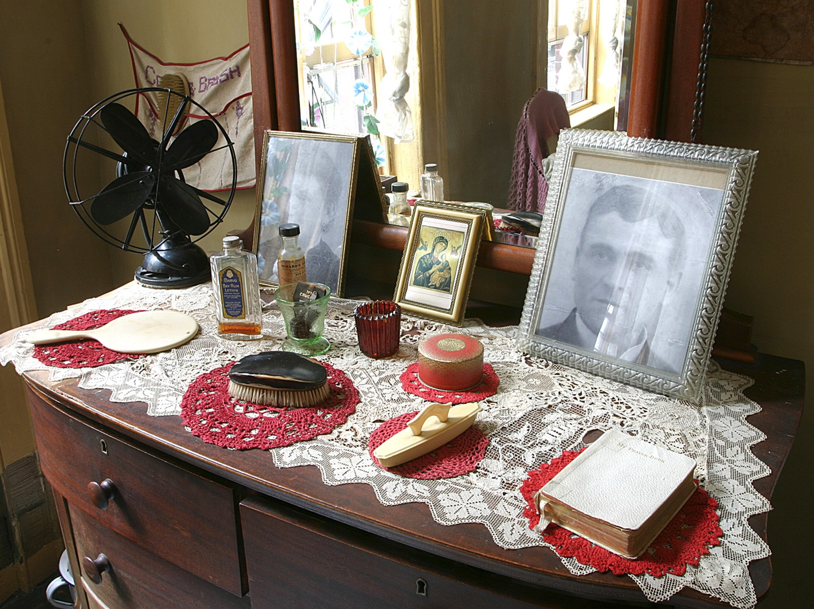 Objects and photos on a dressing table inside the recreated Baldizzi apartment