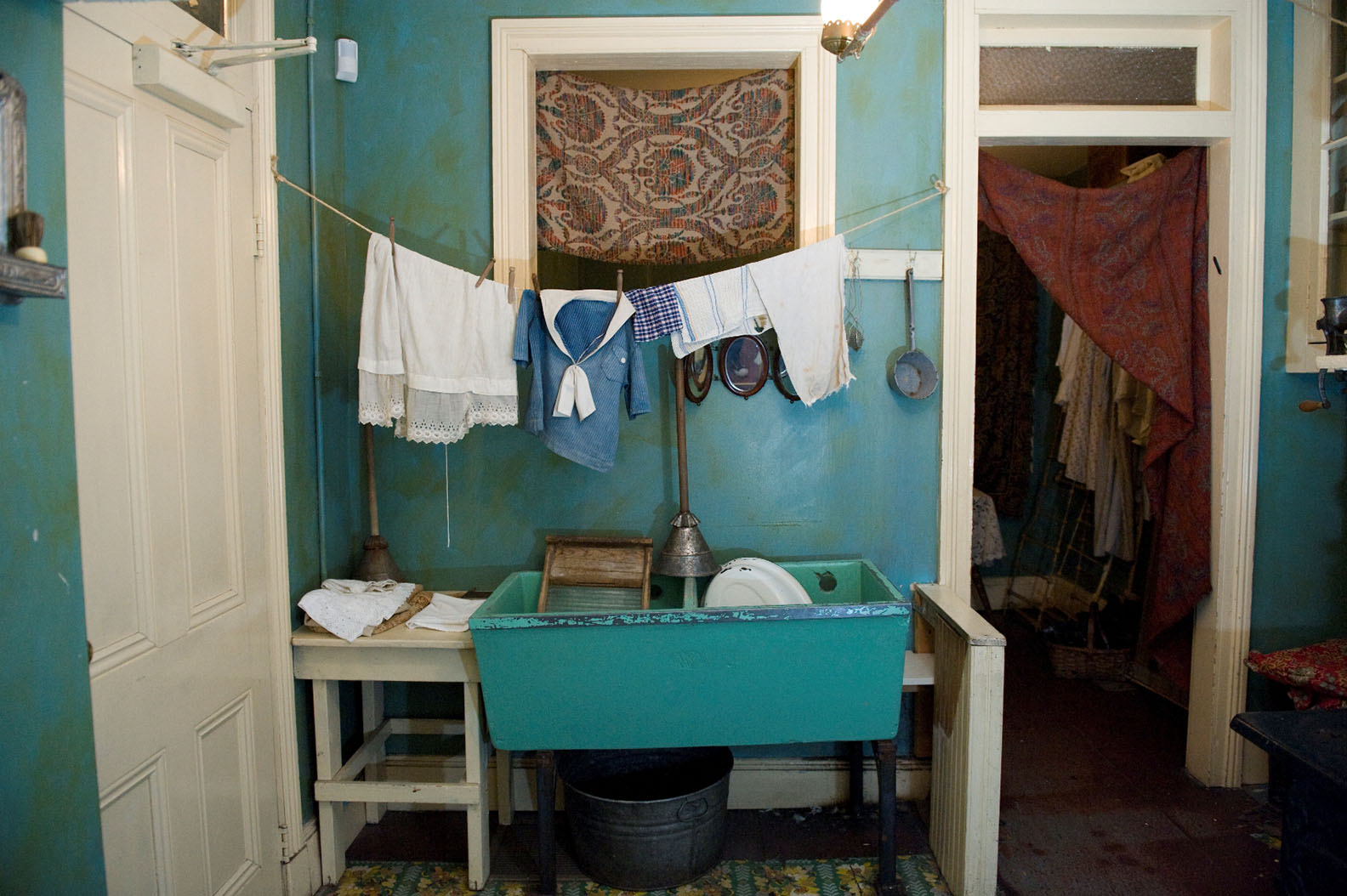 Cloths line hanging over a mounted tub inside the recreated Confino family kitchen