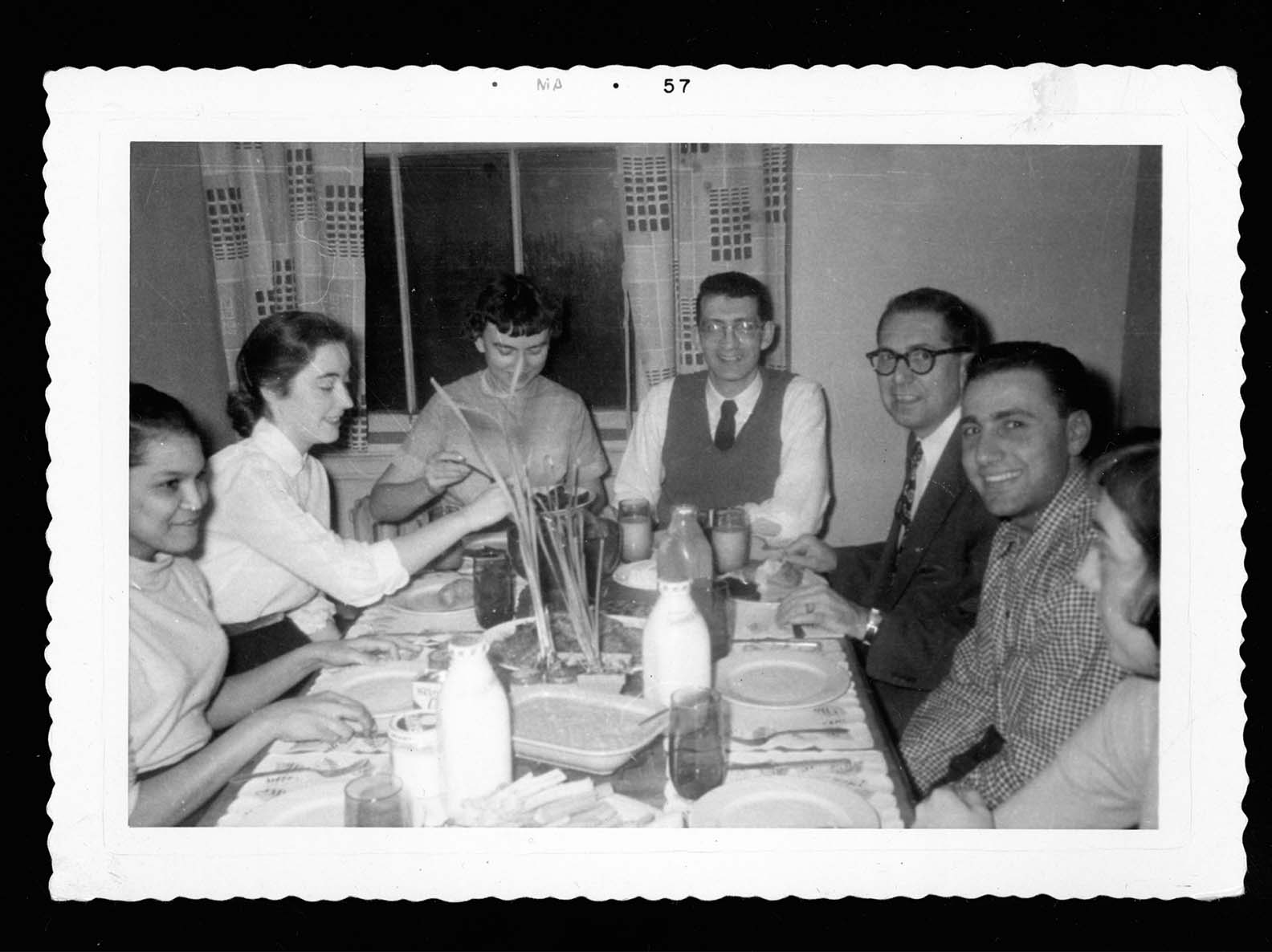 A family meal shared in the 1950s.