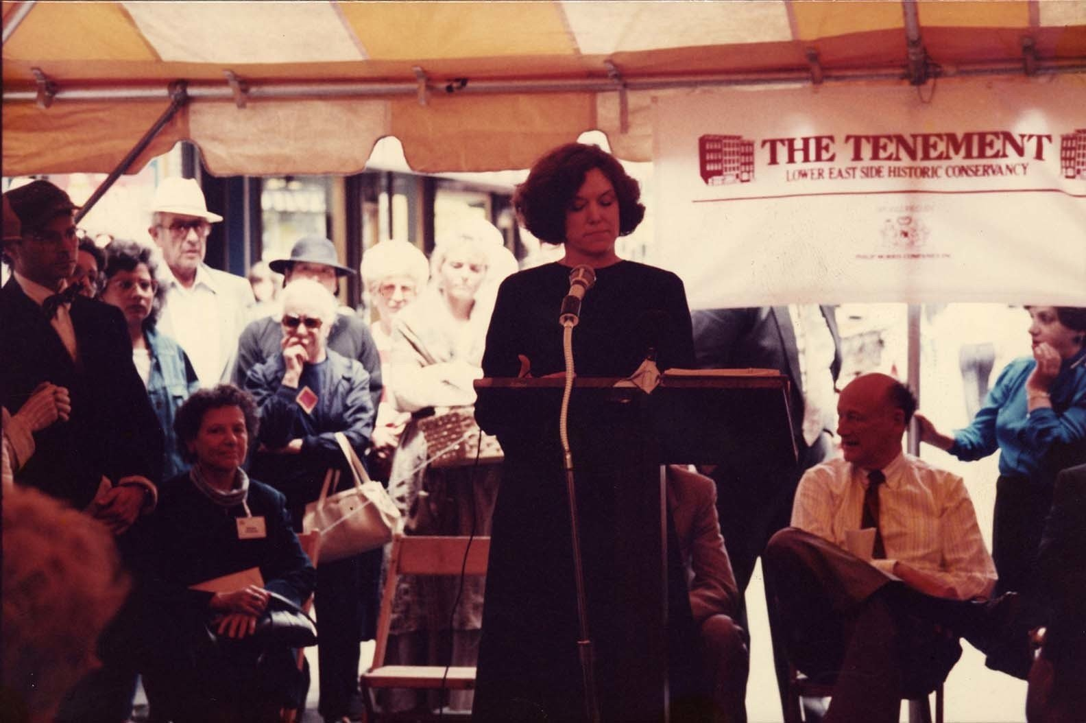Co-founder of the Tenement Museum, Ruth Abram, stands at a podium giving a speech at a Lower East Side Historic Conservancy event.