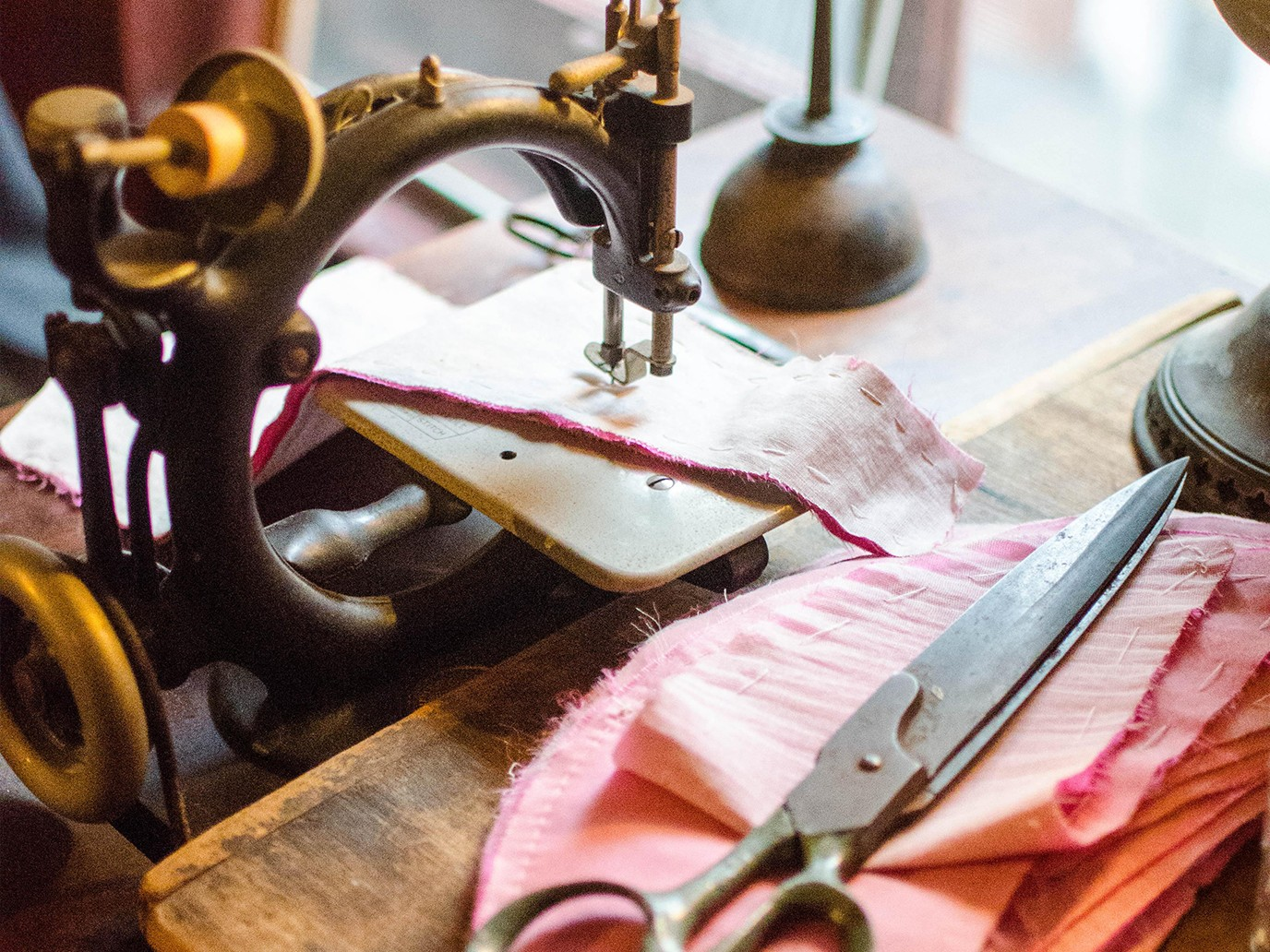 A closeup of the Levine's sewing table inside their recreated 1892 apartment at 97 Orchard Street.