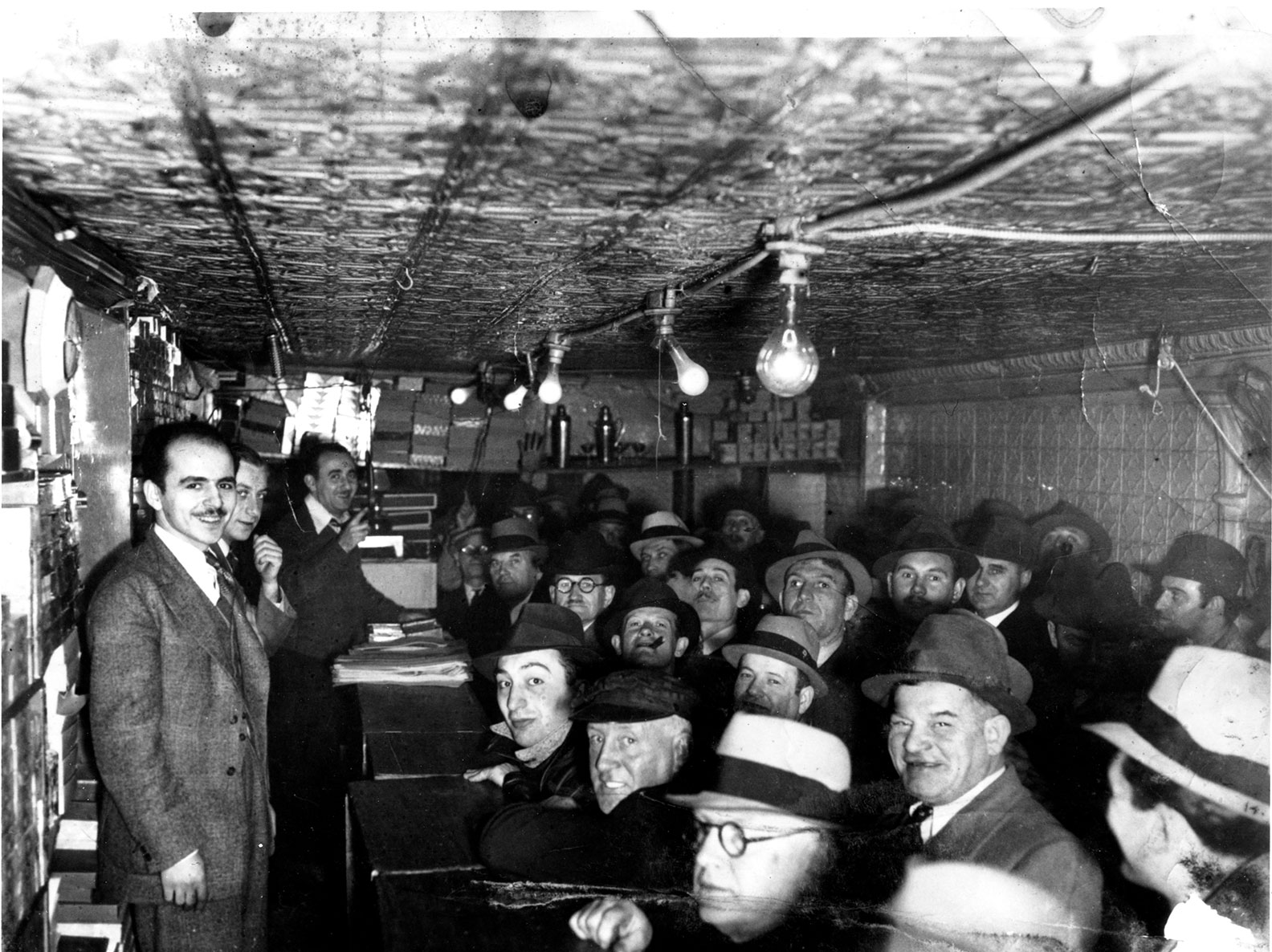 Photo of a group of men in an auction house once operated inside 97 Orchard Street