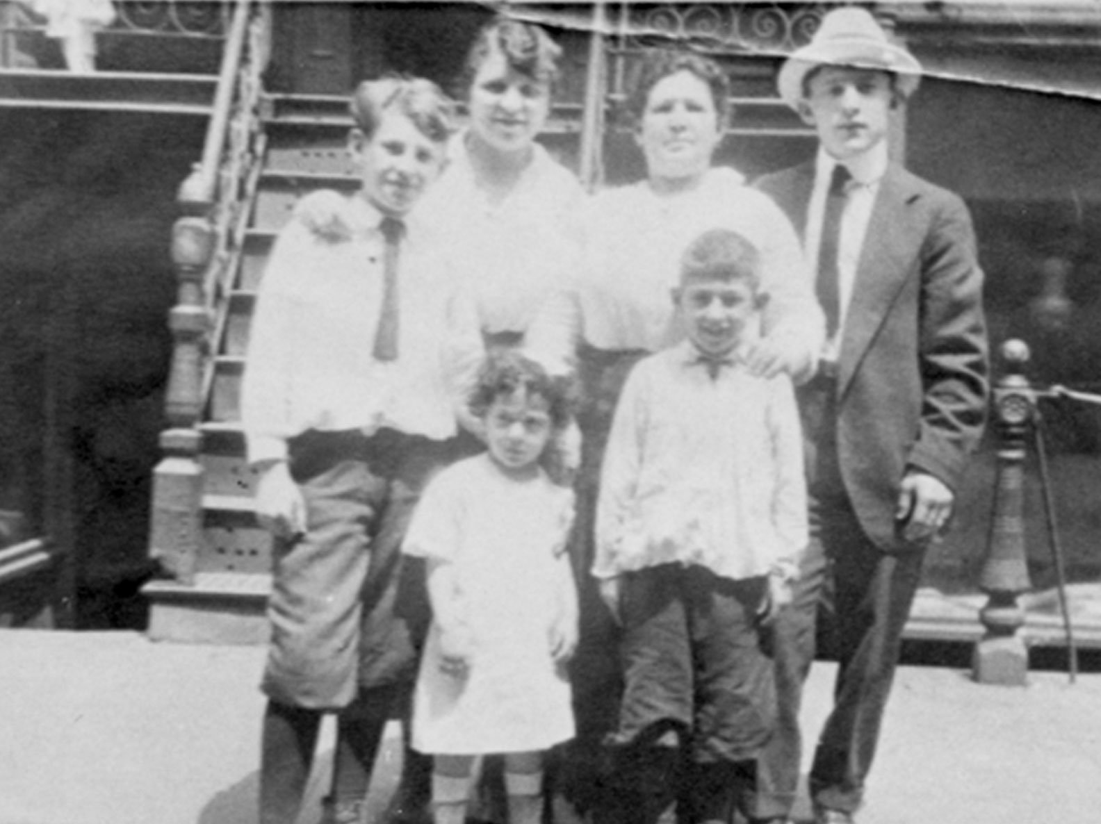 Photo portrait of the Levine family in front of 97 Orchard Street circa 1900