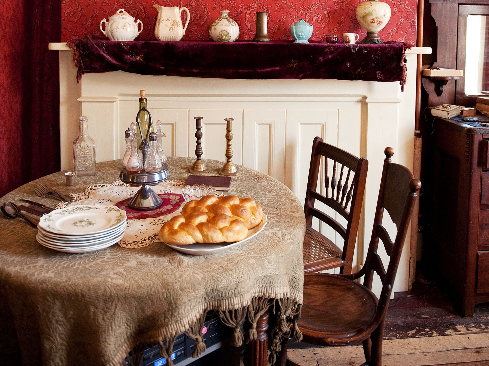 Table set for Sabbath dinner inside the recreated Rogarshevsky parlor