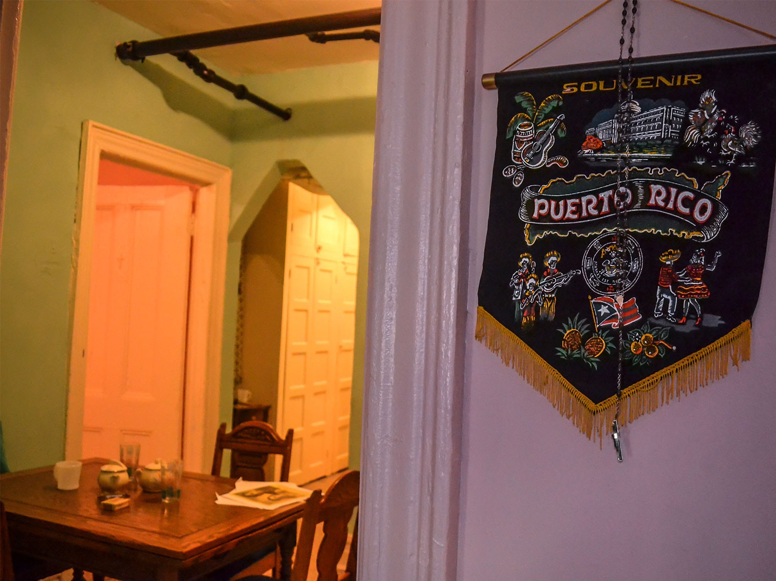 Puerto Rico wall hanging in the Saez-Velez kitchen with the Epstein family dining room in the background