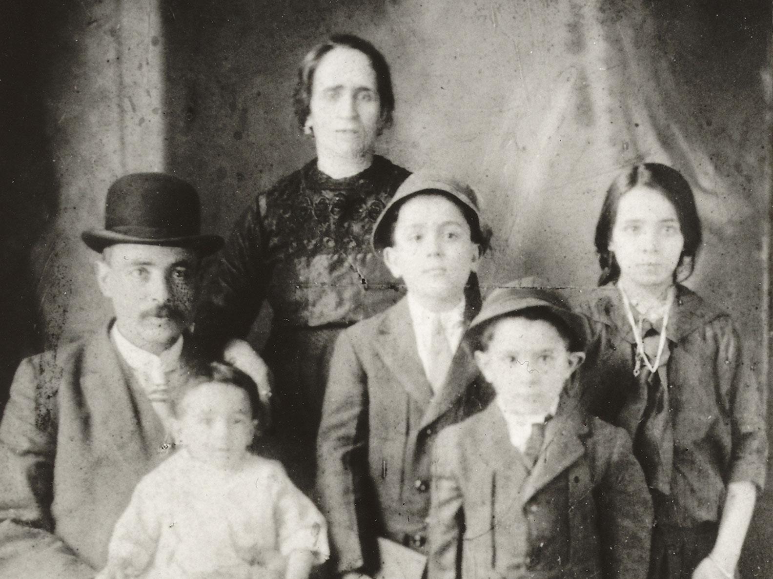 Confino family photo portrait with a young Victoria Confino