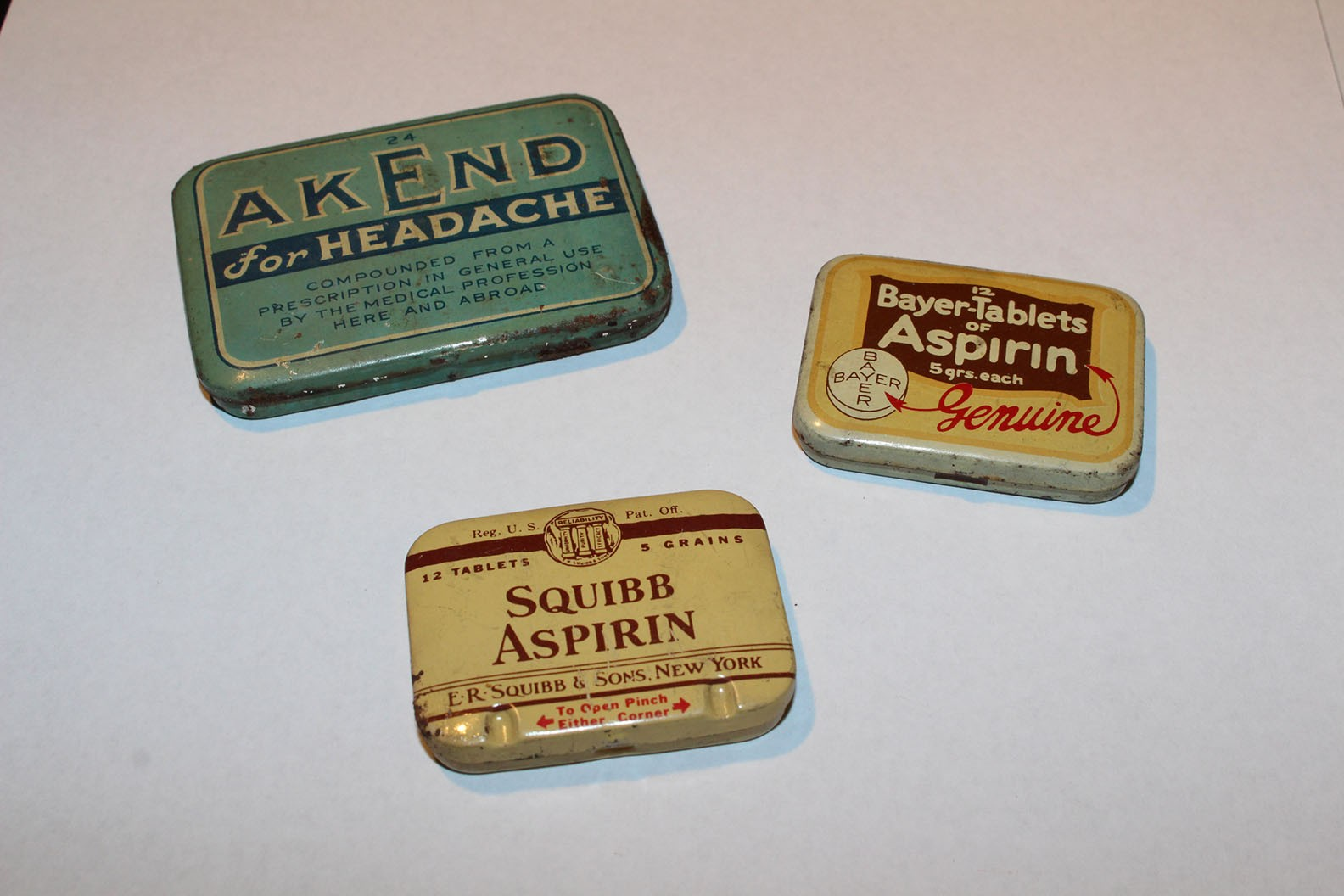 Dated tin box containers for aspirin and other medicine tablets found at 97 Orchard Street