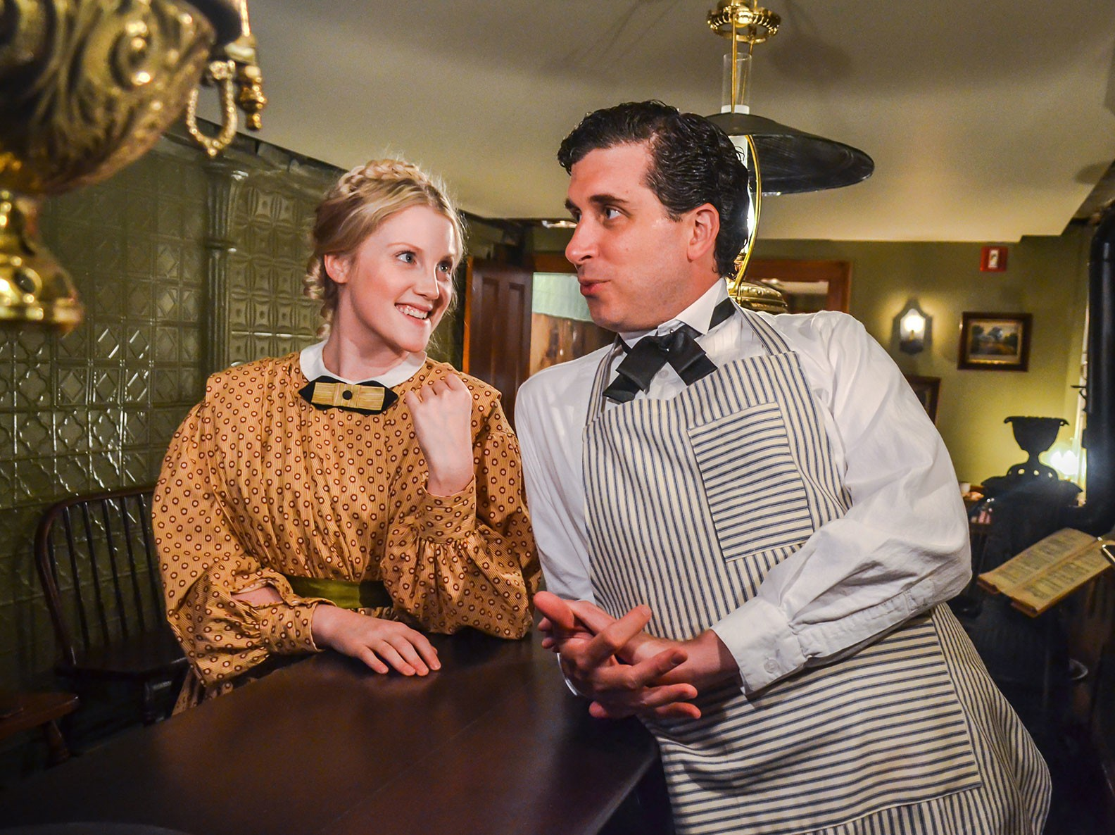 Costumed actors playing John and Caroline Schneider