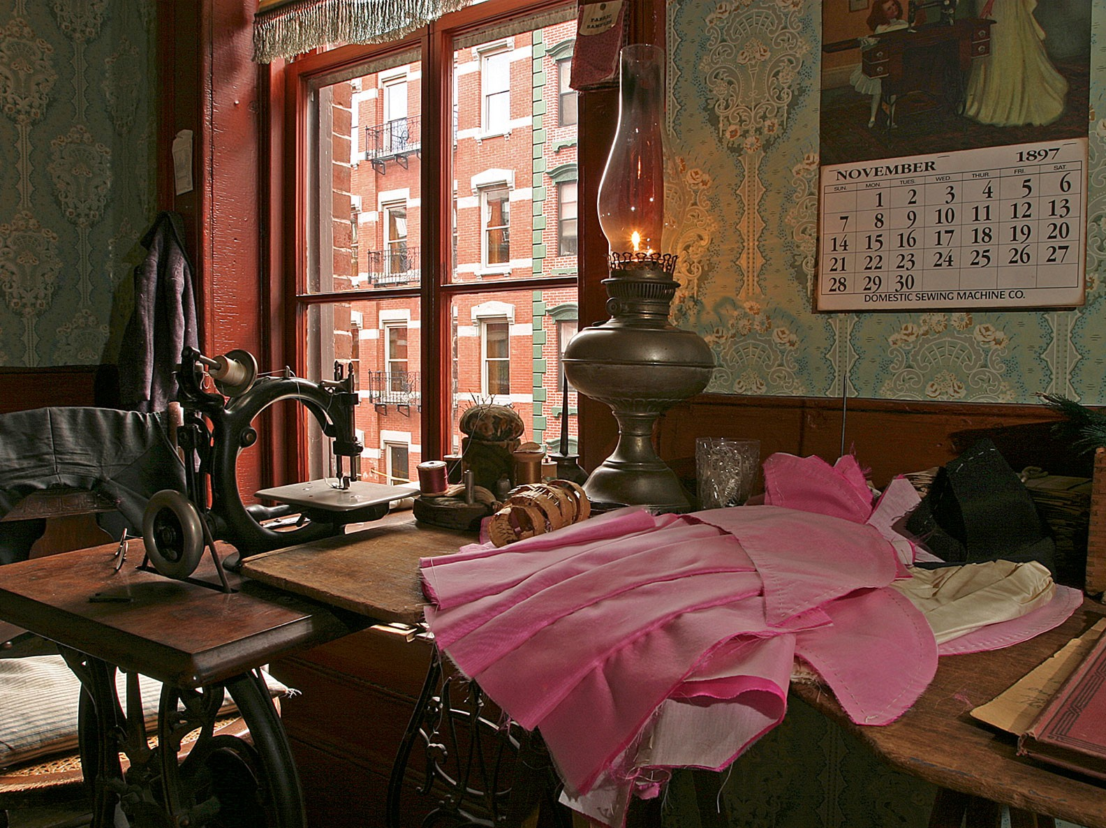 The Levine sewing table inside the parlor of their recreated apartment at 97 Orchard Street