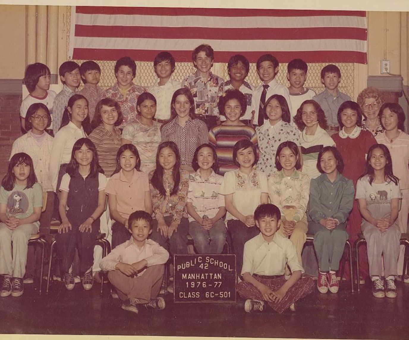 Alison Wong poses with her classmates and teacher for a class picture