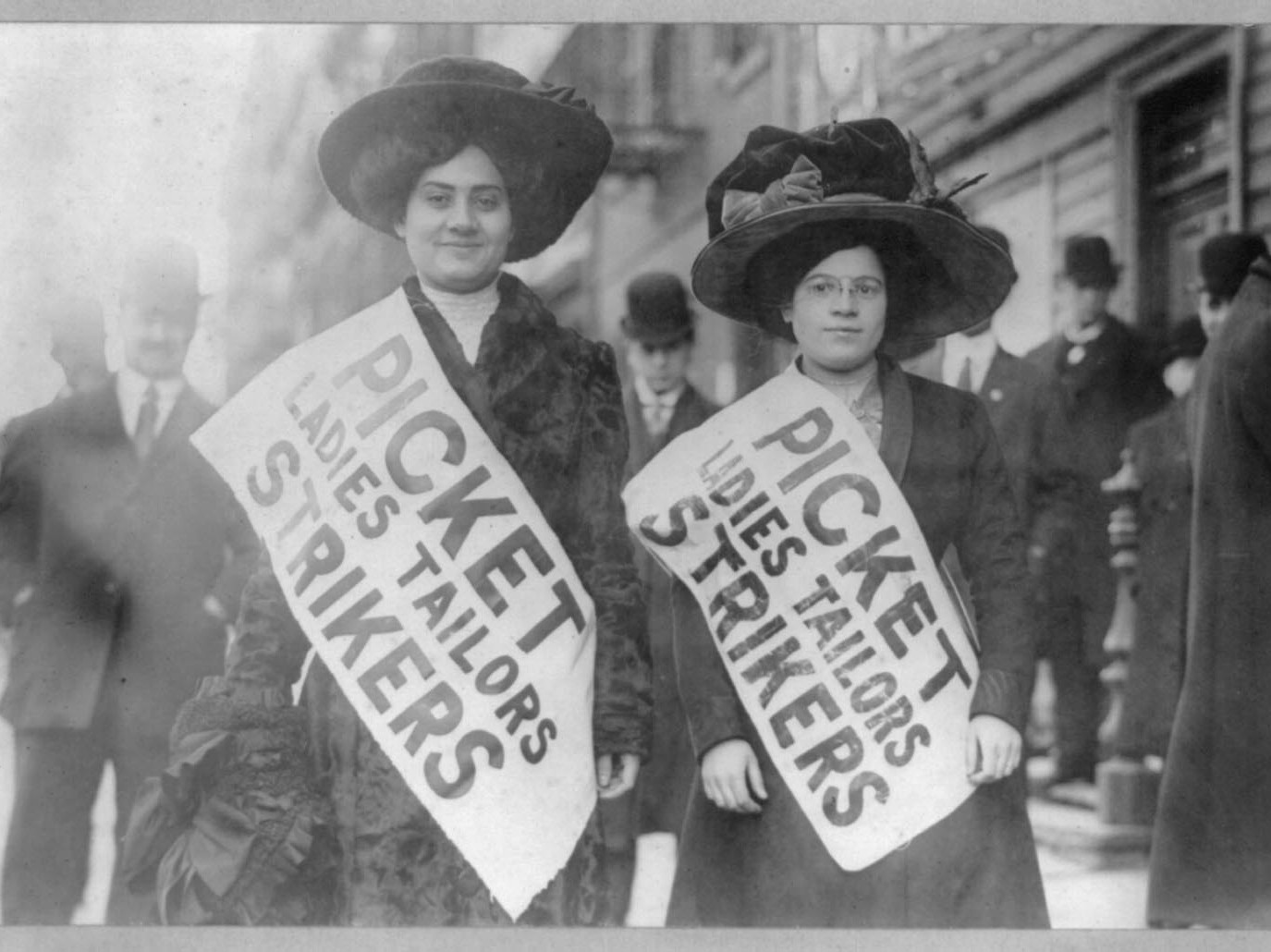 Two women picketing for garment workers rights in 1909.