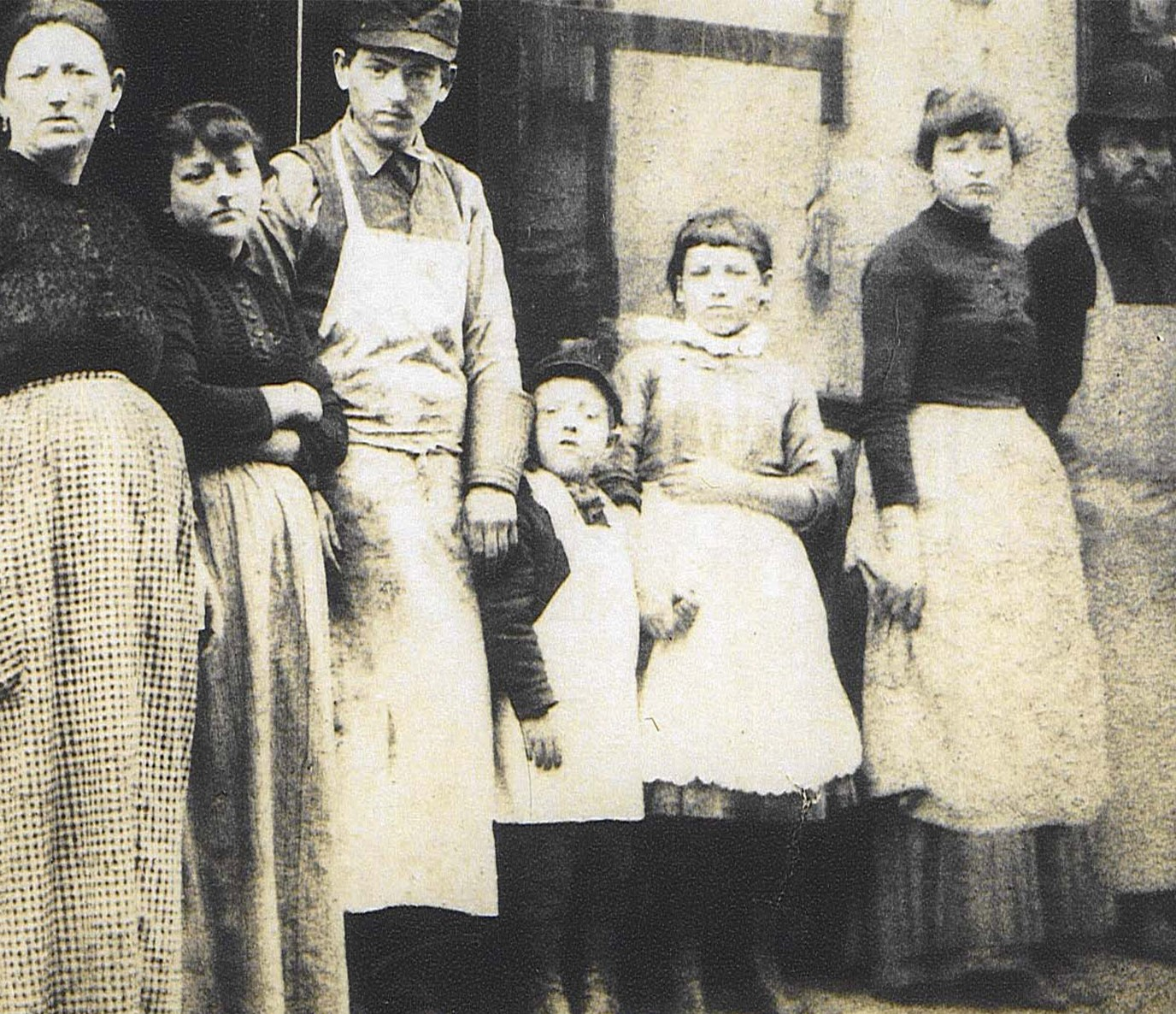 The Lustgarten family posing in front of their kosher butcher shop an 97 Orchard Street.