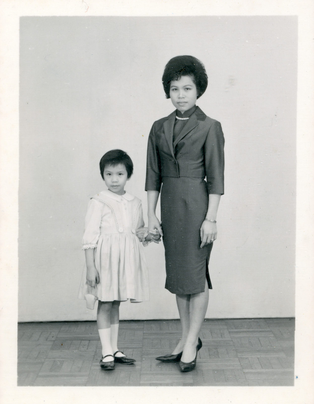 Mrs. Wong and daughter posing for photo circa 1960.