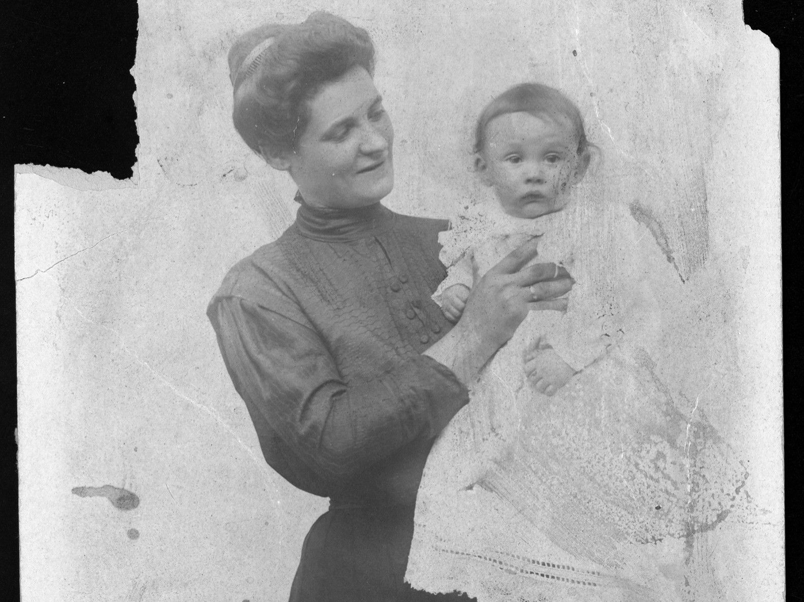 Sarah Burinescu at left holding one on of her children.