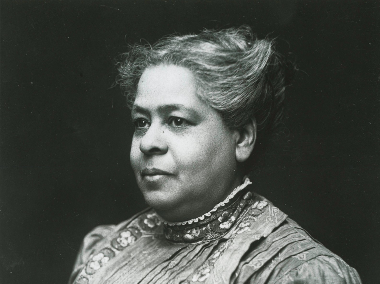 Black and white portrait of Maritcha Lyons, a Black female educator, in formal dress