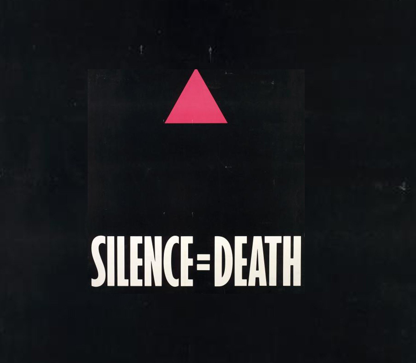 """On a black background, a small bright pink triangle hovers above a sentence that reads """"Silence = Death"""" in bold uppercase block letters"""