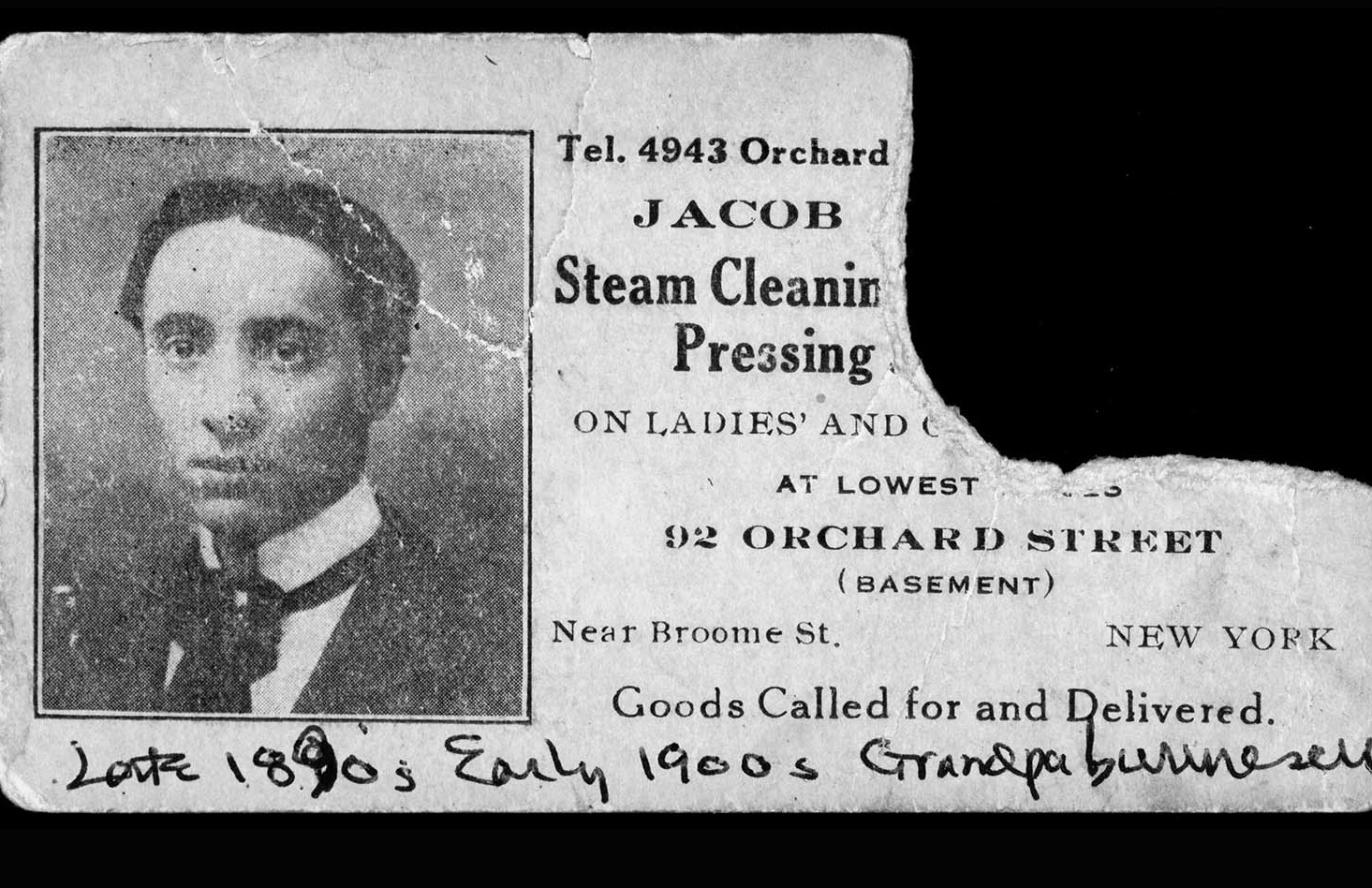 A torn business card with a photo of a young Jacob Burinescu, his address, and a listing of the laundry services he offered