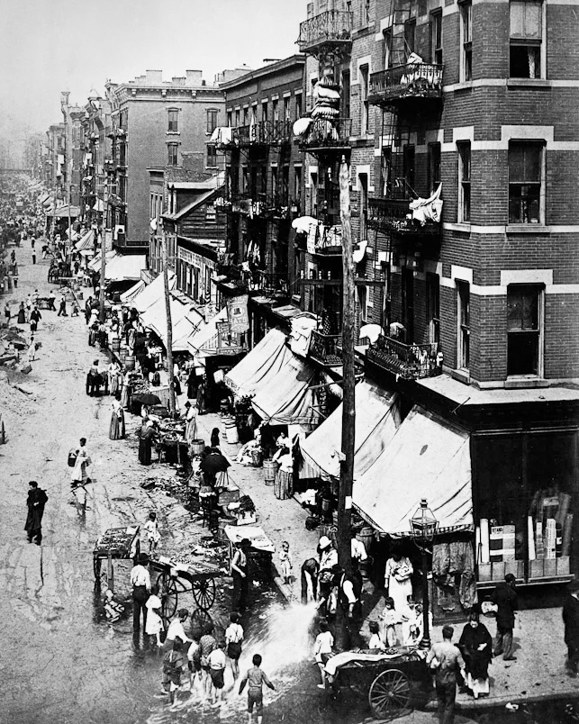 Photo from early 1900s depicting children playing in the street.