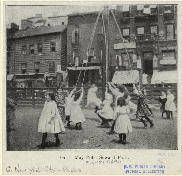 Girls dance around a maypole in Seward Park, 1890s