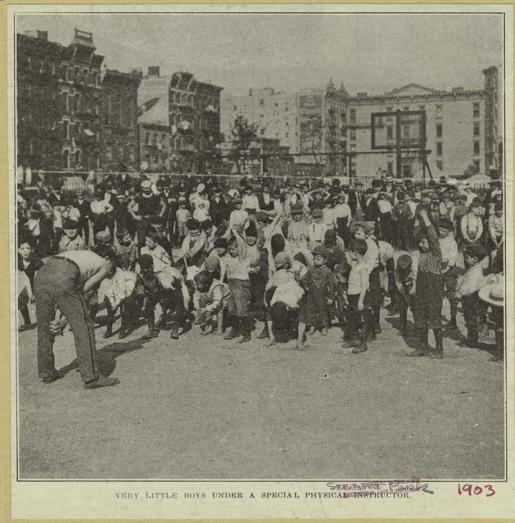 Young boys exercise with an instructor in Seward Park, 1903