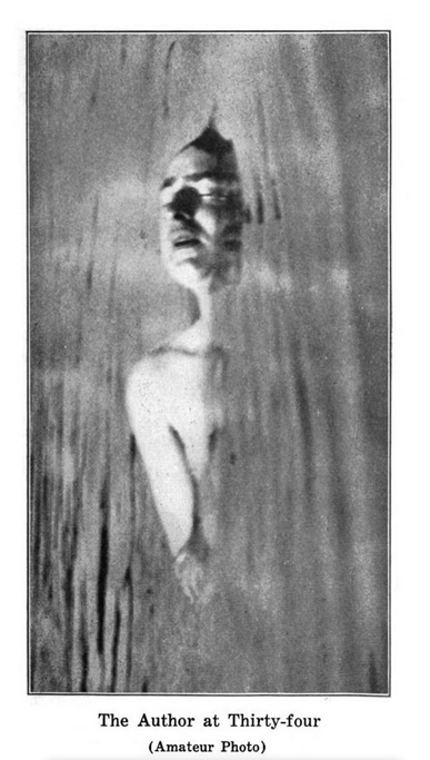 """Portrait of the Author from the shoulders up and partially submerged in water, captioned """"The Author at Thirty-Four (amatuer photo)"""""""