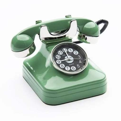 mint green rotary phone with an analog clock face