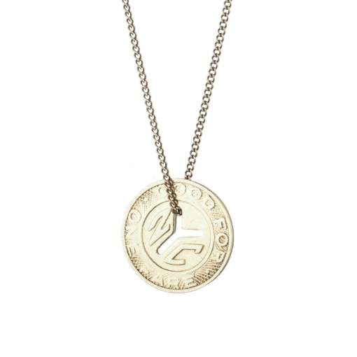 light gold necklace with a re-fashioned subway token on its chain