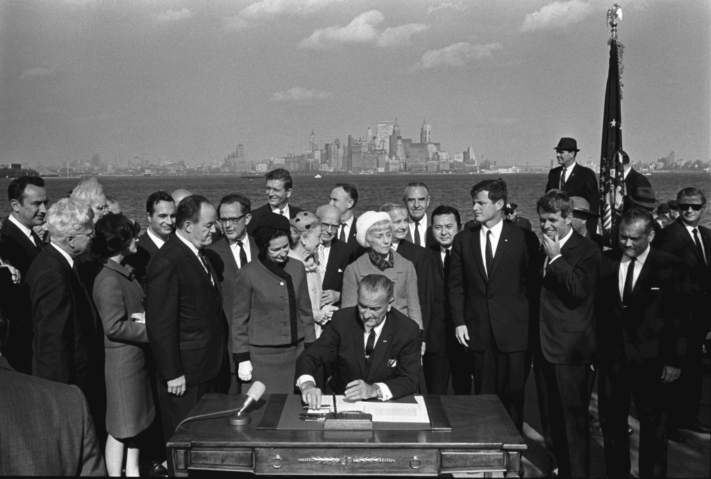 President Lyndon B. Johnson signing the Immigration and Nationality Act, 1965